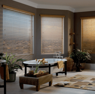austin texas window blinds normandy wood blinds genuine wood blinds bathroom rug bathtub flowers house plants decorated room sundown large wide white window blinds