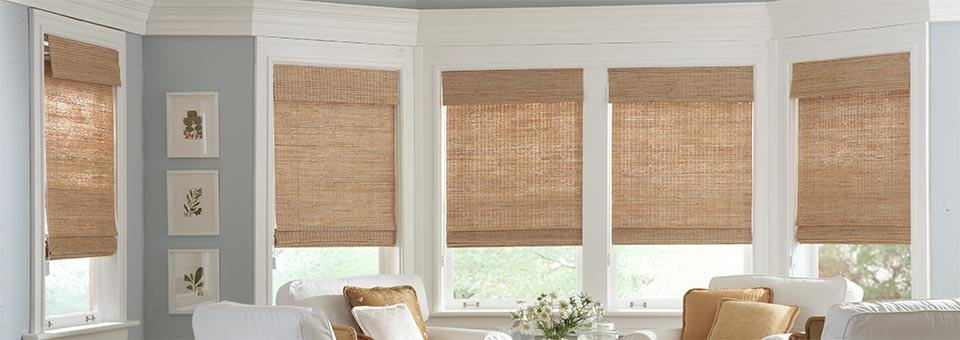 austin texas installed custom exotic rio woven wood shades light brown shades white walls long vertical windows white chairs brown pillows flowers photo frames backyard view