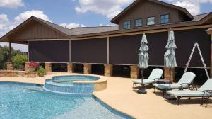 Motorized Shades by Shades of Texas  Austin Texas residential installation backyard pool
