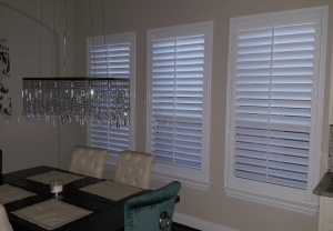 Window Shutters by Shades of Texas Austin Texas home installation dining room