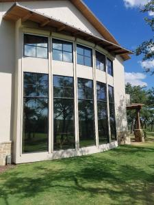 Motorized Shades by Shades of Texas  Austin Texas residential installation backyard